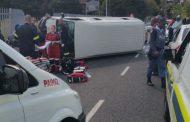 Taxi rolls leaving nine injured