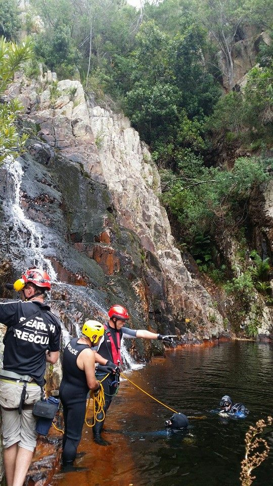 Police search and rescue retrieve body of man from waterfall
