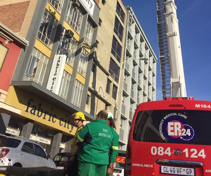 Cape Town Man brought down safely from building