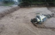 Taxi swept off bridge into the Duzi river