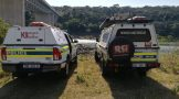 Members of Search and Rescue Unit search for murder victim in the Tugela river