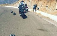 What does a motorcycle helmet placed on the road surface/ ground mean?