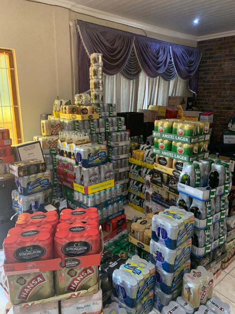 Eight suspects found with counterfeit liquor and cigarettes